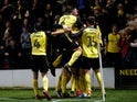 Burton Albion's Nathan Broadhead celebrates scoring their second goal with teammates on September 25, 2019