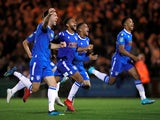 Colchester United players celebrate after winning the penalty shootout against Tottenham Hotspur on September 24, 2019