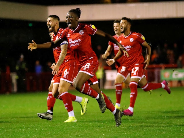 Crawley Town's David Sesay and teammates celebrate winning the penalty shootout against Stoke on September 24, 2019