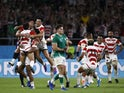Japan's players celebrate beating Ireland at the 2019 Rugby World Cup on September 28, 2019