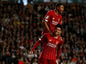 Much-changed Liverpool beat MK Dons to book place in fourth round