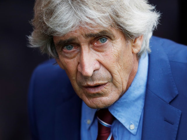 West Ham manager Manuel Pellegrini spots the camera on September 28, 2019