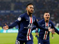 Paris Saint-Germain's Neymar celebrates scoring their first goal against Lyon on September 22, 2019