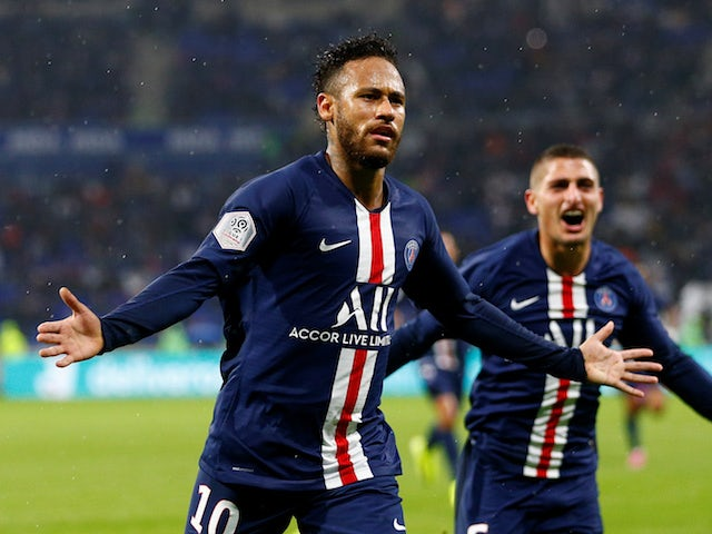 Paris Saint-Germain's Neymar celebrates scoring their first goal against Lyon on September 22, 2019