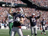 New England Patriots running back Rex Burkhead (34) reacts after his touchdown run against the New York Jets in the third quarter at Gillette Stadium on September 22, 2019