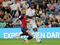 Real Madrid's Vinicius Junior in action with Osasuna's Lillo Castellano in La Liga on September 25, 2019