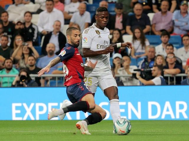 Real Madrid's Vinicius Junior in action with Osasuna's Lillo Castellano in La Liga on September 25, 2019