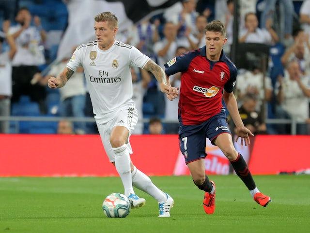 Real Madrid's Toni Kroos in action with Osasuna's Marc Cardona in La Liga on September 25, 2019