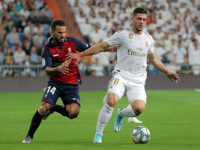 Real Madrid's Luka Jovic in action with Osasuna's Ruben Garcia in La Liga on September 25, 2019