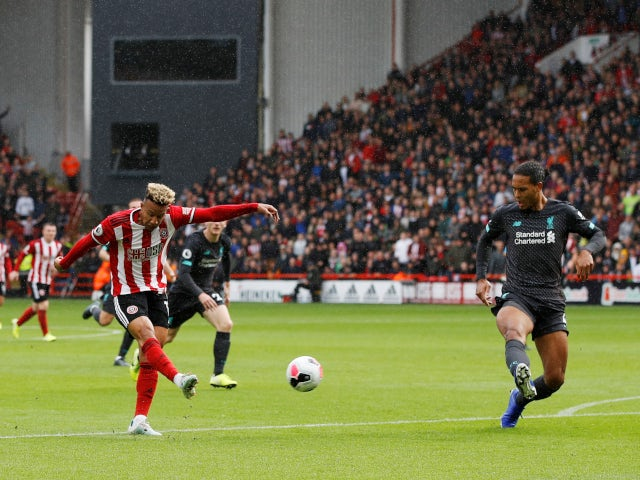 Sheffield United's Callum Robinson gets a shot away against Liverpool in the Premier League on September 28, 2019.