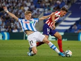 Real Sociedad's Martin Odegaard in action with Atletico Madrid's Marcos Llorente in La Liga on September 14, 2019