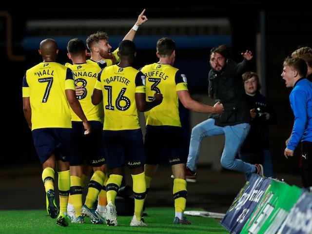 Oxford United's Matty Taylor celebrates scoring their second goal against West Ham with teammates and fans on September 25, 2019