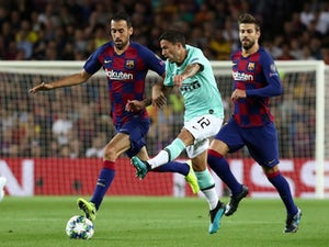 Barcelona's Sergio Busquets in action with Inter Milan's Stefano Sensi in the Champions League on October 2, 2019