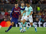 Inter Milan's Alexis Sanchez in action with Barcelona's Clement Lenglet in the Champions League on October 2, 2019