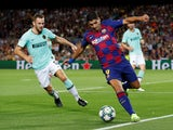 Barcelona's Luis Suarez in action with Inter Milan's Stefan de Vrij in the Champions League on October 2, 2019