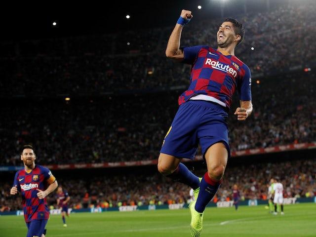 Barcelona's Luis Suarez celebrates scoring their first goal against Sevilla on October 6, 2019