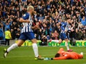 Brighton and Hove Albion's Aaron Connolly celebrates scoring their third goal as Tottenham Hotspur's Paulo Gazzaniga looks dejected on October 5, 2019