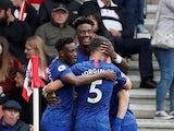 Chelsea's Tammy Abraham celebrates scoring their first goal with Callum Hudson-Odoi and team mates on October 6, 2019