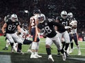 Oakland Raiders running back Josh Jacobs (28) celebrates after scoring on a 12-yard touchdown run in the first quarter against the Chicago Bears during an NFL International Series game at Tottenham Hotspur Stadium on October 6, 2019