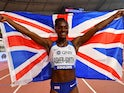 Great Britain's Dina Asher-Smith celebrates after winning gold on October 2, 2019