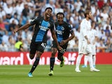 Club Brugge's Emmanuel Dennis celebrates scoring their first goal against Real Madrid on October 1, 2019