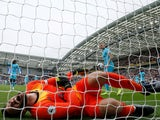 Spurs keeper Hugo Lloris lies injured on October 5, 2019
