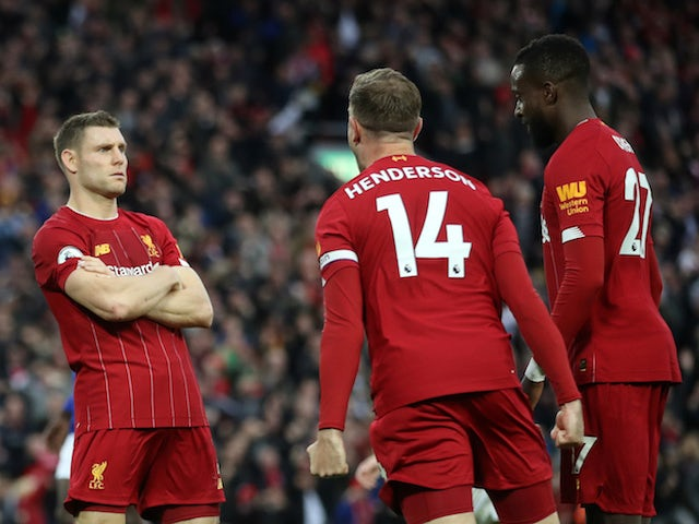 Liverpool's James Milner celebrates scoring their second goal with Jordan Henderson and Divock Origi on October 5, 2019