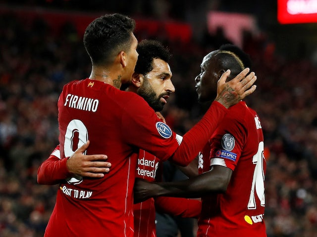Liverpool's Mohamed Salah celebrates scoring their third goal with team mates on October 2, 2019