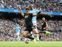 Raul Jimenez and Fernandinho in action during the Premier League game between Manchester City and Wolverhampton Wanderers on October 6, 2019