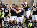 Tom Bradshaw celebrates with Millwall teammates after scoring on October 5, 2019