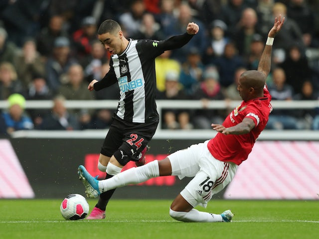 Manchester United's Ashley Young in action with Newcastle United's Miguel Almiron in the Premier League on October 6, 2019