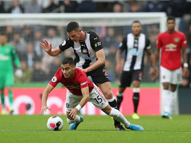 Newcastle United's Ciaran Clark in action with Manchester United's Andreas Pereira in the Premier League on October 6, 2019