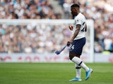 Tottenham Hotspur's Serge Aurier looks dejected as he walks off after being shown a red card on September 28, 2019