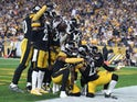 The Pittsburgh Steelers defense celebrates an interception in the end-zone by inside linebacker Mark Barron (26) against the Cincinnati Bengals during the fourth quarter at Heinz Field on October 1, 2019