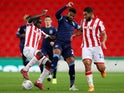 Stoke City's Badou Ndiaye and Cameron Carter-Vickers in action with Huddersfield Town's Steve Mounie on October 1, 2019