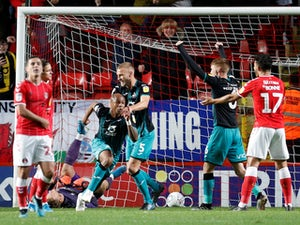 Swansea move top with comeback win over Charlton