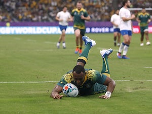 Australia respond with seven-try win over Uruguay