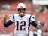 New England Patriots quarterback Tom Brady (12) gestures while running not the field for warmups prior to the Patriots game against the Washington Redskins at FedExField on October 6, 2019