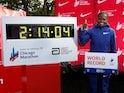 Kenya's Brigid Kosgei celebrates winning the women's marathon next to her new world record time