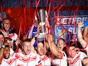 St Helens players lift the trophy as they celebrate their win against Salford Red Devils on October 12, 2019