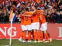 Netherlands' Memphis Depay celebrates scoring their third goal with teammates