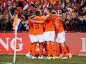Netherlands' Memphis Depay celebrates scoring their third goal with teammates