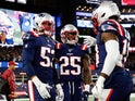New England Patriots middle linebacker Kyle Van Noy (53) celebrates with defensive back Terrence Brooks (25) and wide receiver Matthew Slater (18) after scoring against the New York Giants during the second half at Gillette Stadium on October 11, 2019