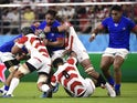 Samoa's Jack Lam in action with Japan's Pieter Labuschagne and Kazuki Himeno on October 5, 2019