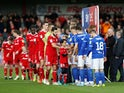 The players shake hands before the match between Accrington and Ipswich on October 20, 2019