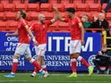 Charlton's Macauley Bonne celebrates scoring their first goal with team mates on October 19, 2019