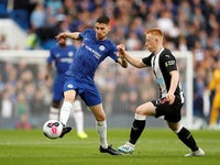 Jorginho and Matty Longstaff in action during the Premier League game between Chelsea and Newcastle United on October 19, 2019