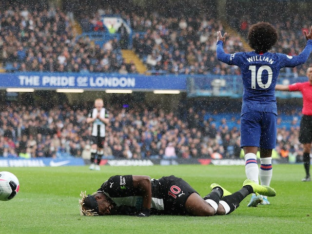 Allan Saint-Maximin and Willian in action during the Premier League game between Chelsea and Newcastle United on October 19, 2019