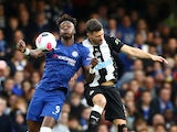 Tammy Abraham battles with Fabian Schar during the Premier League game between Chelsea and Newcastle United on October 19, 2019