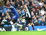 Miguel Almiron takes on Kurt Zouma during the Premier League game between Chelsea and Newcastle United on October 19, 2019